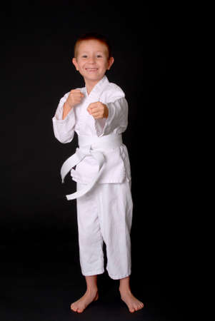kata: Young boy in karate outfit making fighting movement Stock Photo