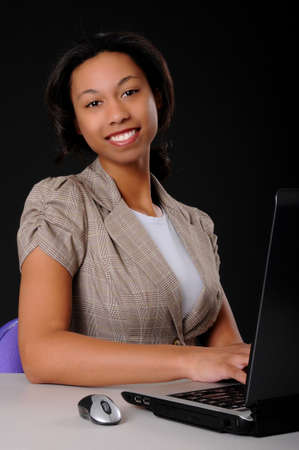Lovely brunette business woman working at computer laptop Stock Photo - 9015321