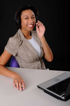 Lovely brunette business woman working at computer laptop Stock Photo - 9015244