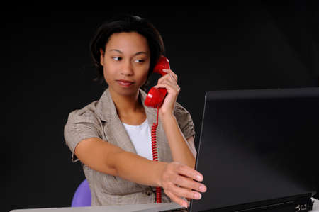 Lovely brunette business woman working at computer laptop Stock Photo - 9015234