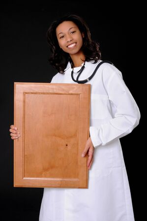 Lovely young and beautiful black Doctor or Nurse holding a sign or frame photo