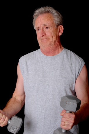 Senior citizen fitness training by lifting weights photo