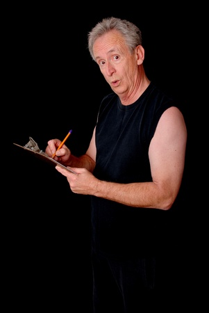hait: Senior citizen fitness trainer writing on a clipboard