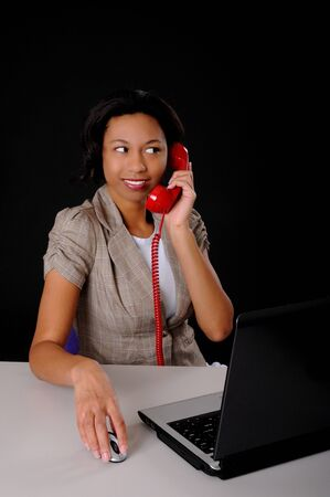 Lovely brunette business woman working at computer laptop Stock Photo - 9015631