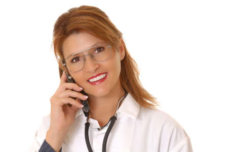 Lovely young and beautiful Doctor or Nurse talking on a cell phone photo