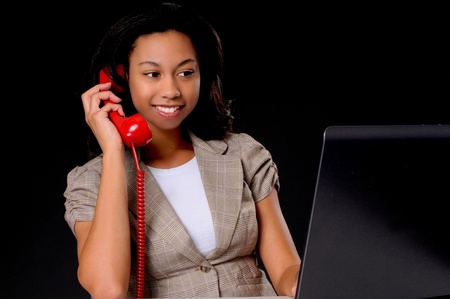 Lovely African American business woman working at computer laptop Stock Photo - 9016061