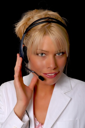 Lovely blond business woman working on headset phone photo