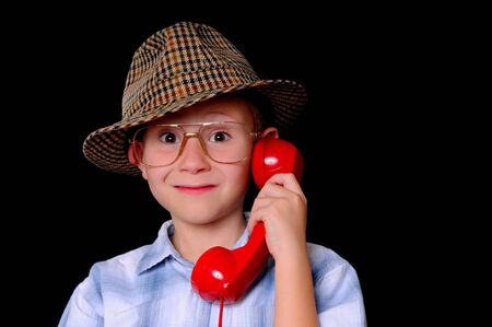 Young boy businessman dressed casually and listening on the telephone Imagens - 9016138