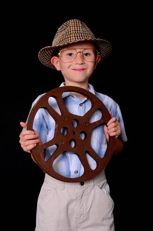 Young boy businessman dressed casually hold a 16mm film reel