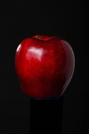 Red delicious apple isolated on black photo