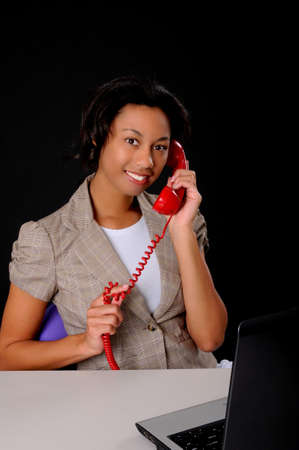 Lovely African American business woman working at computer laptop Stock Photo - 9016629