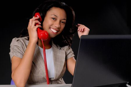 help: Lovely African American business woman working at computer laptop Stock Photo