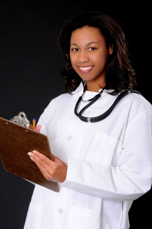 Lovely young and beautiful african american Doctor or Nurse  Standard-Bild