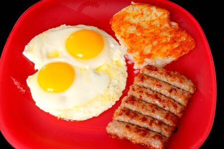 Tradition breakfast of eggs, sausage, and hash brown potatoes