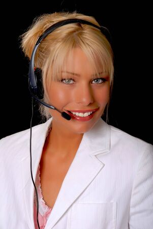 Isolated lovely and sexy young blond businesswoman wearing a headset phone photo