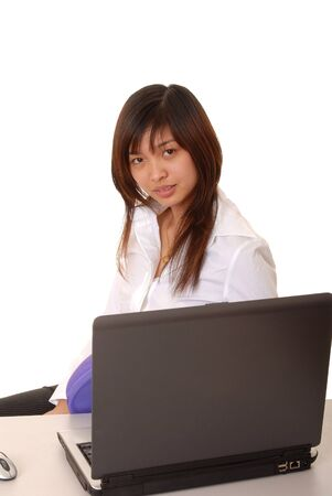 Lovely Asian business woman hard at work photo