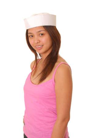 Isolé belle et sexy jeune asiatique fille porter le chapeau du marin Banque d'images - 9124090