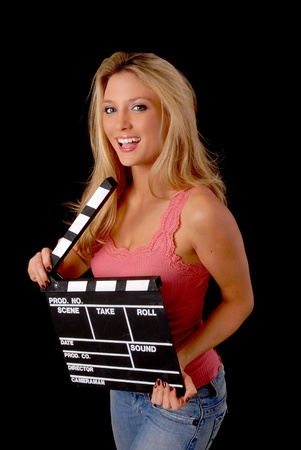 Isolated lovely and sexy young blond girl holding a cinema clapboard Stok Fotoğraf