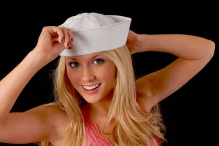 Isolated lovely and sexy young blond girl wearing a sailors  photo