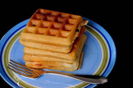 Blueberry waffles on plate isolated on black
