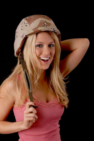 Isolated lovely and sexy young blond girl wearing a Army helmet  photo