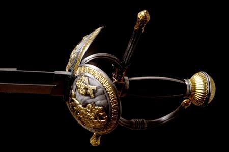 hilt: Sword hilt pommel blade and handle isolated over black