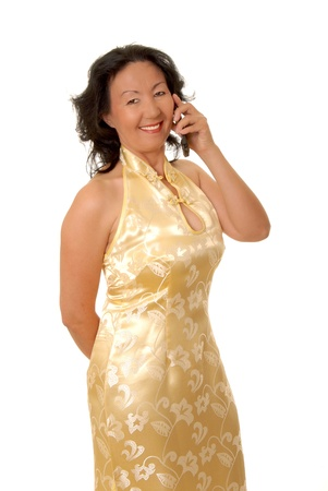 Portrait of a lovely asian businesswoman talking on a phone photo
