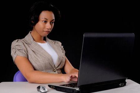 Lovely African American business woman at work Stock Photo - 9216986