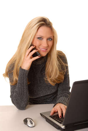 Lovely blond business woman hard at work photo