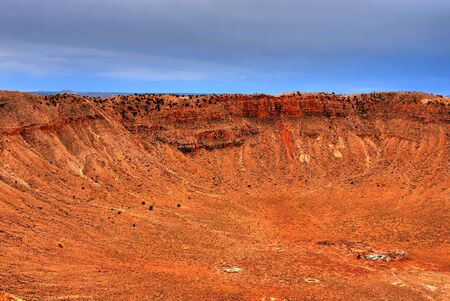 Meteor crater in Arizona with storm approaching Stock Photo