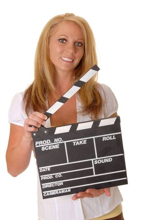 Isolated lovely and sexy young blond girl holding a cinema clapboard photo