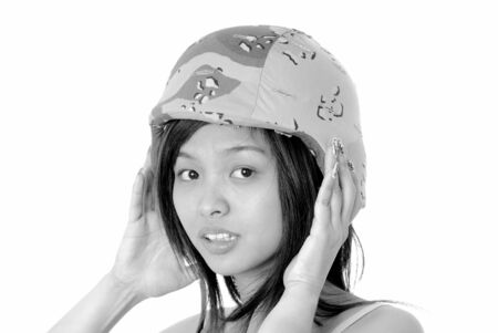 Isolated lovely and beautiful young Asian girl wearing a army helmet Stock Photo - 9217288