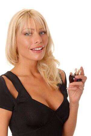 Lovely isolated blond girl spraying on perfume Banco de Imagens - 9217082