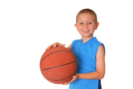 Young boy playing with a basketball isolated on white photo
