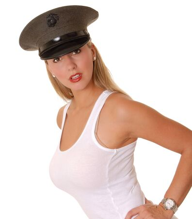 sexy blond: Isolated lovely and sexy young blond girl wearing a Marine cap