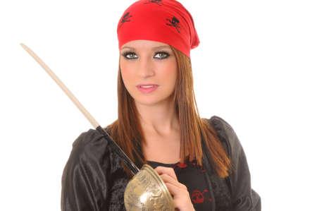 cutlass: Una ni�a encantadora pirata con un remate Foto de archivo