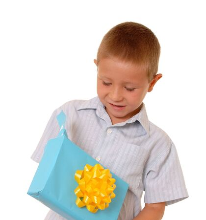 Boy opening a wrapped gift isolated over white Stock Photo