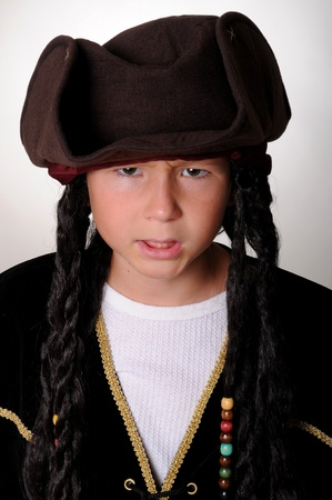 Young boy wearing a pirates costume Imagens