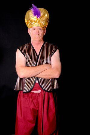 sheik: An elder sultan or sheik isolated over black