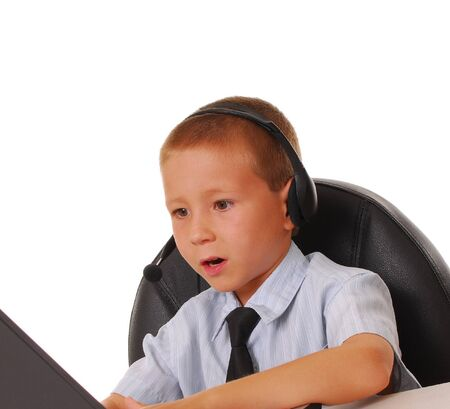 A Young boy businessman hard at work photo