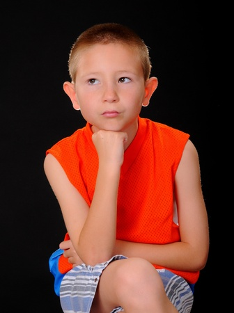 Portrait of a young boy wearing sports clothing photo