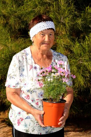 A Senior woman tending to a garden photo
