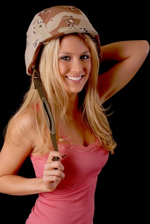 Sexy young blond girl wearing a military helmet Stock Photo - 9504843
