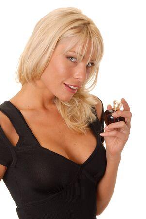 Girl applying perfume from a perfume bottle