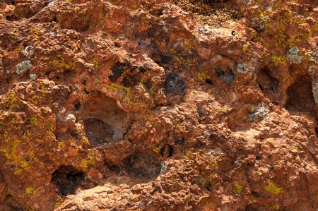 granular: Very rough and granular rock texture