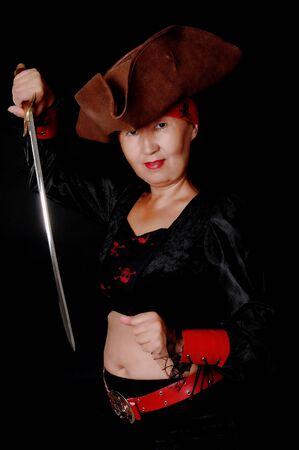 cutlass: Una chica hermosa pirata con un cutlass Foto de archivo