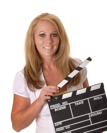 Isolated lovely and sexy young blond girl holding a cinema clapboard Stock fotó