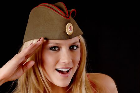 russian hat: Isolated lovely and sexy young blond girl wearing a soviet army cap Stock Photo