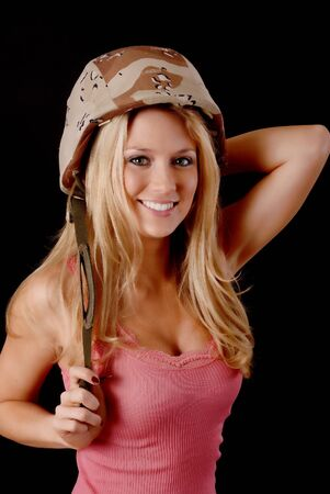 Isolated lovely and sexy young blond girl wearing a Army helmet Stock Photo - 9723418
