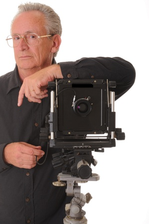 tripod mounted: Senior photographer with a large format camera on tripod Stock Photo